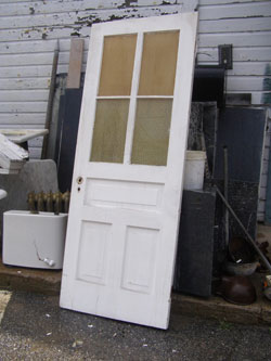 photo of painted white door, salvage yard