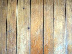Hardwood floor with gaps.