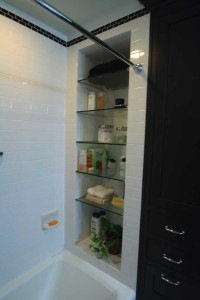 Photo of glass shelves inside tub area.