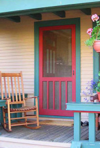 photo of red painted door with aqua door trim.