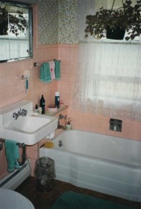 Downstairs bathroom before the remodel, in its full pink and flowery glory.