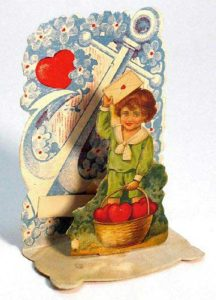 Valentine pop-up of boy with basket of hearts.