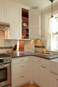 Use photo of close-up of kitchen corner with pass-through door above countertop.