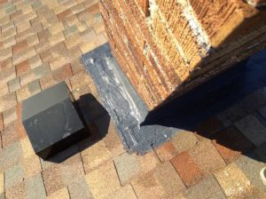 Photo of sealant at chimney base.