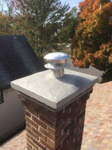 Chimney with cap and vent.