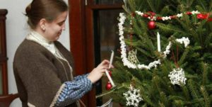 photo of woman decorating tree