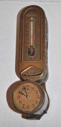 photo of thermostat with round clock face at bottom.