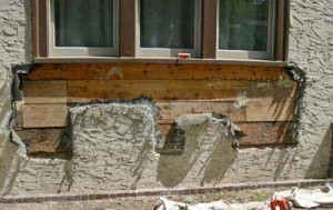 Once the window box was removed, the walls' substructure was revealed. Two areas of rotted boards were patched.